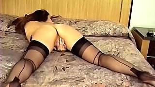 ANTIQUE BROWN-HAIRED MASTURBATES IN HER STOCKINGS